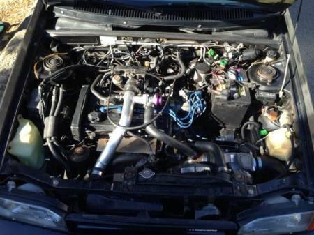 1988 Mazda 323 GTX black engine