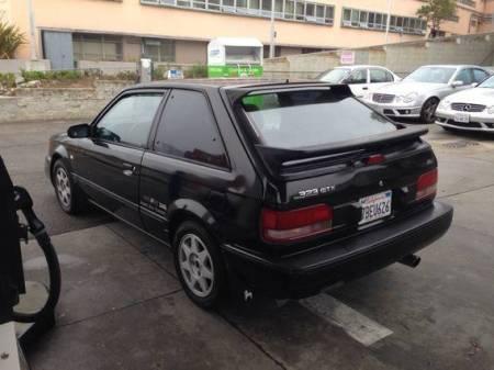 1988 Mazda 323 GTX black left rear