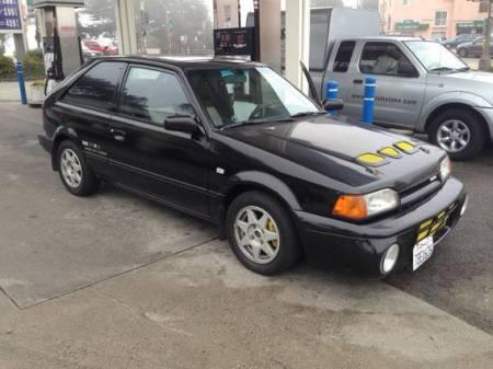 1988 Mazda 323 GTX black right front
