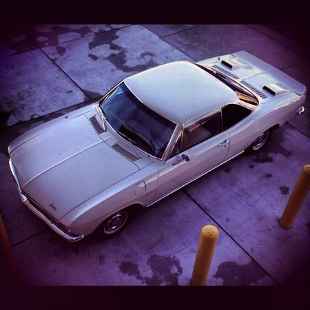 1965 Chevrolet Corvair 500 coupe above